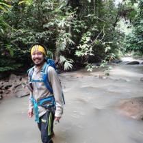 Seth Wong walking through a stream
