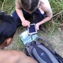 Jurgen Niedballa showing Len how to transfer camera trap data