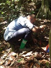 John Mathai collecting soil samples